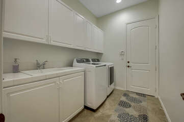 Fully equipped laundry room with washer, dryer, ironing board, and iron. Pro traveler tip: wash your clothes before you check-out, with Tide Pods provided by Vacay Stay, and arrive home with fresh clothes.