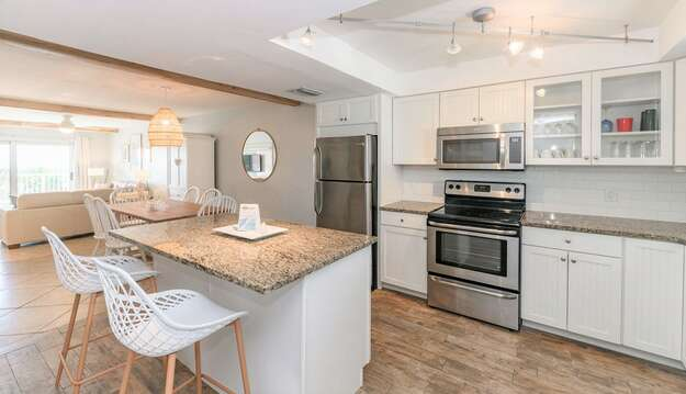 Renovated kitchen with island, stainless steel appliances