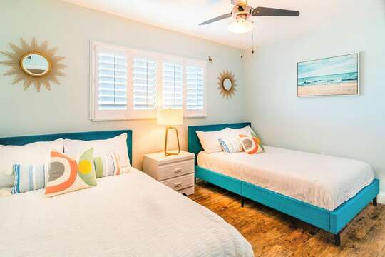 Guest bedroom with two double beds and a closet