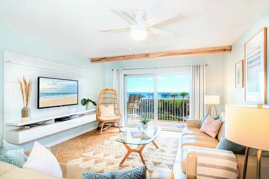 Beautiful coastal living room with views of the pool, ocean and pier - walks directly out to the balcony!