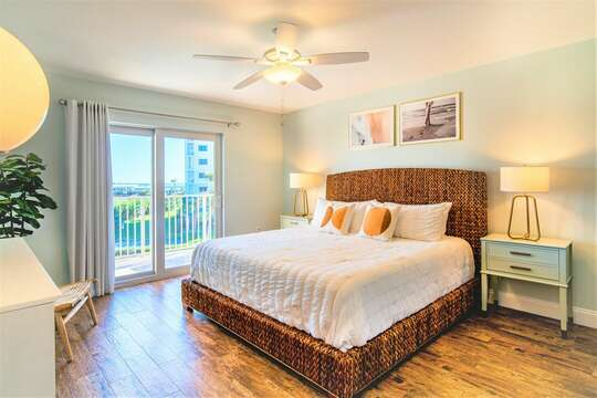 Serene Master Bedroom complete with a King Bed, flatscreen TV & lots of closet space.