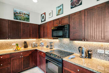 Fully Equipped Kitchen with Granite Counter Tops and Dark Wood Cabinets