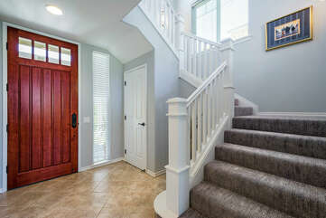 Large Wooden Front Door and Staircase to the 2nd Level