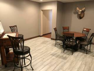 Bonus Room with Large Round Table and Cooler
