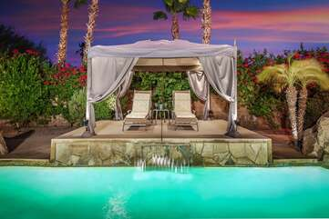 The cabana in the upper landing patio is sure to impress and keep you cool with extra shade.