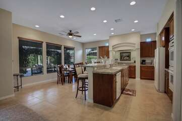 The spacious gourmet kitchen will be fully equipped to cook your favorite meals.