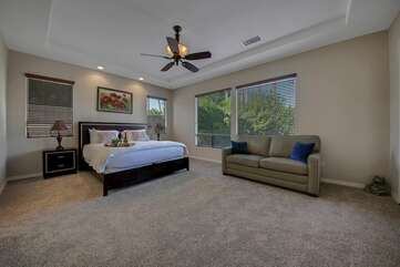 Master Suite 1 features a Cal King-sized Bed, Full-sized Sofa Sleeper, and access to the back patio.