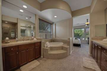 Master Suite 1 bathroom features a jacuzzi tub, tile shower, and two vanity sinks.