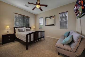 Suite 2 is located at the end of the hallway on the right and features a  Queen-sized Bed, Twin-sized Sofa Sleeper, 50-inch TCL by Roku Smart television, with access to the back patio.