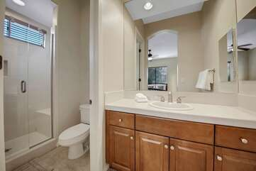Suite 2 features a private, en suite bathroom with a tile shower and sink.
