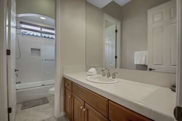 The hallway bathroom is located next to Suite 2 and features a combo shower/tub.