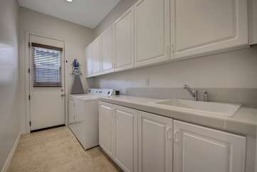 Fully equipped laundry room with washer, dryer, ironing board, and iron. Plenty of detergent provided so you can arrive at home with fresh clothes.