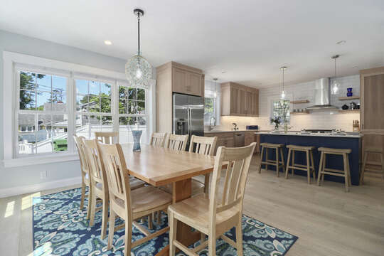 Dining room opens into kitchen with center island seating for 4. stainless appliances.-16 Middleton Drive West Harwich Cape Cod -New England Vacation Rentals
