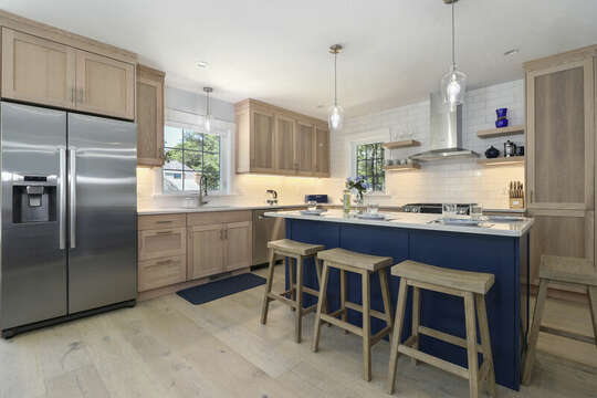 Kitchen with center Island seats 4. Stainless appliances with modern coastal decor.-16 Middleton Drive West Harwich Cape Cod -New England Vacation Rentals