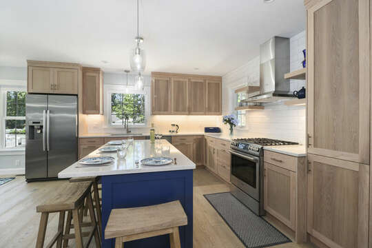 Kitchen with stainless stove and stainless refrigerator. Ample counter top and cabinet space.-16 Middleton Drive West Harwich Cape Cod -New England Vacation Rentals