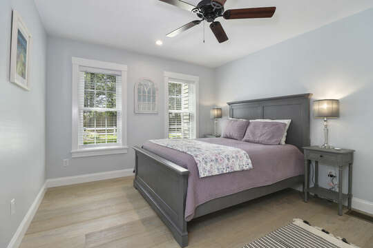 Bedroom #1 With a queen bed, ceiling fan, nightstands and en-suite bath all in a modern coastal decor.-16 Middleton Drive West Harwich Cape Cod -New England Vacation Rentals