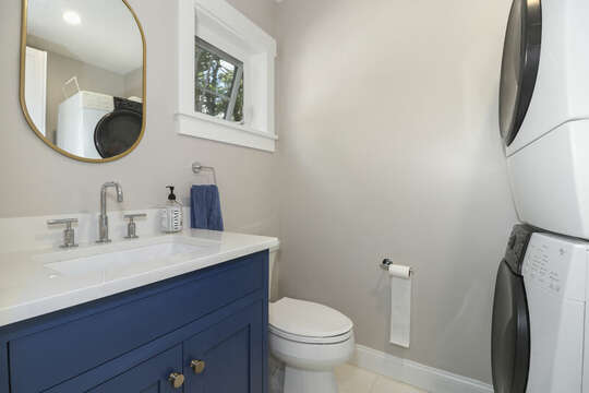 Bathroom #1 - half bath and laundry area with stack able washer and dryer-16 Middleton Drive West Harwich Cape Cod -New England Vacation Rentals
