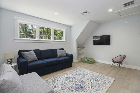 Second Floor extra living space or loft space with couches and flat screen tv- great space for the kids to play games and relax-16 Middleton Drive West Harwich Cape Cod -New England Vacation Rentals