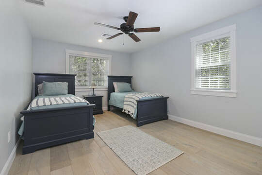 Bedroom #2 - Two twin beds , ceiling fan and nightstand. 2 closets and built in shelves-16 Middleton Drive West Harwich Cape Cod -New England Vacation Rentals