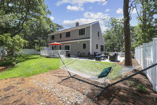 Fenced in back yard with hammock, patio and deck seating-16 Middleton Drive West Harwich Cape Cod -New England Vacation Rentals