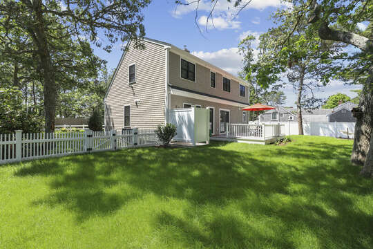 Fenced in Back yard with outdoor shower-16 Middleton Drive West Harwich Cape Cod -New England Vacation Rentals