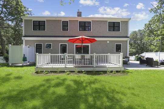 Fenced in back yard with out door shower , deck and patio-16 Middleton Drive West Harwich Cape Cod -New England Vacation Rentals