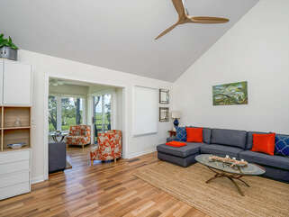 Living room adjacent to sun room with vaulted ceiling