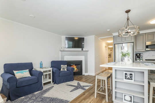 Open concept Kitchen living area, flat scene tv and gGas fire place - 405 Old Wharf Road-Dennisport Cape Cod- New England Vacation Rentals