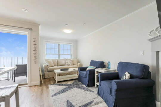 Living room with Couch and chairs with entrance to balcony - 405 Old Wharf Road-Dennisport Cape Cod- New England Vacation Rentals