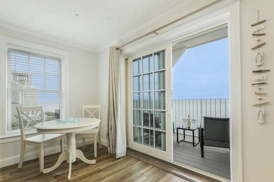 Bistro table and sliders to balcony overlooking the Ocean - 405 Old Wharf Road-Dennisport Cape Cod- New England Vacation Rentals
