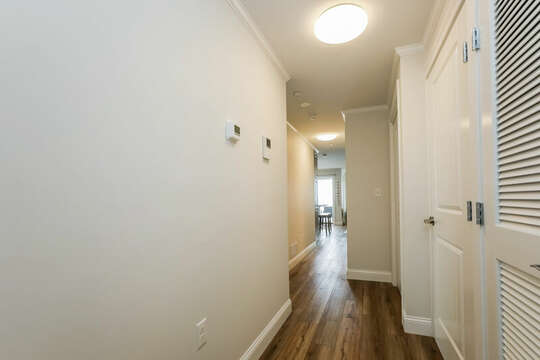 Hallway with stackable washer dryer in the closet - 405 Old Wharf Road-Dennisport Cape Cod- New England Vacation Rentals