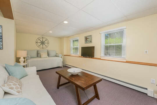 Finished basement with additional couch and day bed with flat screen TV- 80 Lienau Dr Chatham Ma - Cape Cod- New England Vacation Rentals