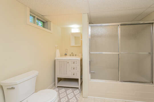 Bath room #3 in finished basement with shower/ tub combo, vanity and toilet. 80 Lienau Dr Chatham Ma - Cape Cod- New England Vacation Rentals