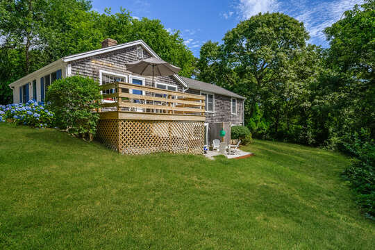 Private back yard with mature trees and conservation area. 80 Lienau Dr Chatham Ma - Cape Cod- New England Vacation Rentals