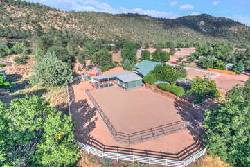 Aerial view of guesthouse, horse stalls and turn out areas.