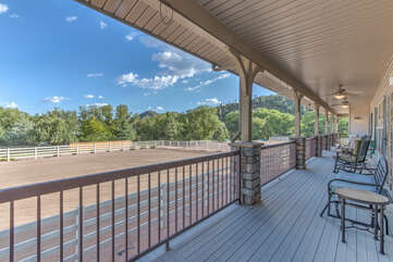 Front porch of the main home offers comfortable seating and terrific views of arena and beyond.