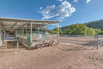 Horse stalls are supplied with mats, water tanks, ground hay bins, hanging grain feeders and fans