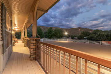 Stellar views of the lighted, groomed, 90 x 120 foot riding arena from deck of main house.