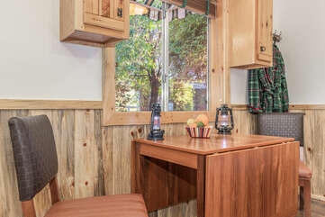 Drop leaf table offers a cozy place to sip coffee or enjoy private meals.