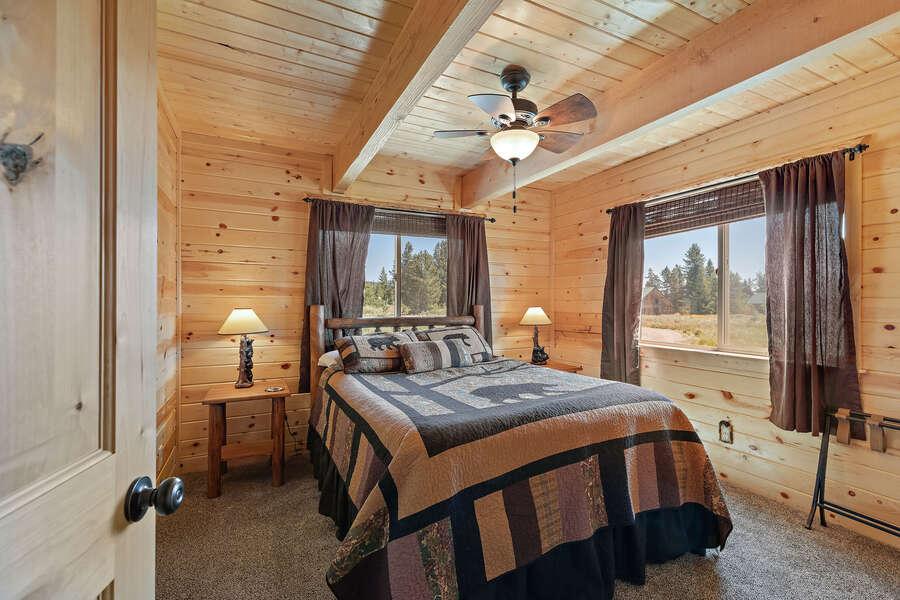 Shotgun Sunset ~ main level bedroom w/ queen bed
