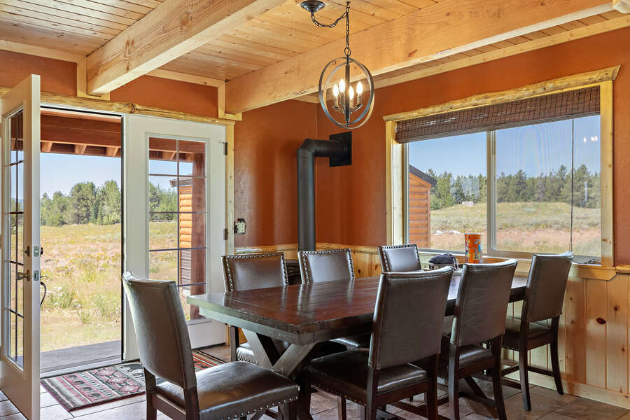 Shotgun Sunset ~ large dining table and french doors
