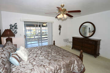 Primary Bedroom with Queen Bed and access to lanai and water views