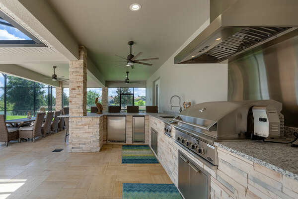 The outdoor summer kitchen offers ample space for those creating large meals