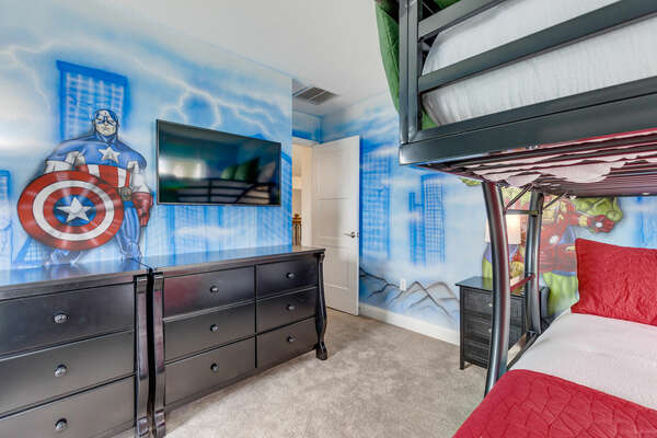 With 2 sets of full over full bunkbeds and a large TV to watch their favorite superheroes on