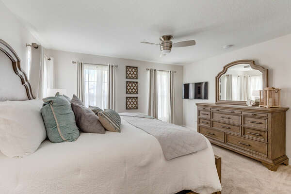 Plush king-size bed and large wooden dresser to meet all of your needs