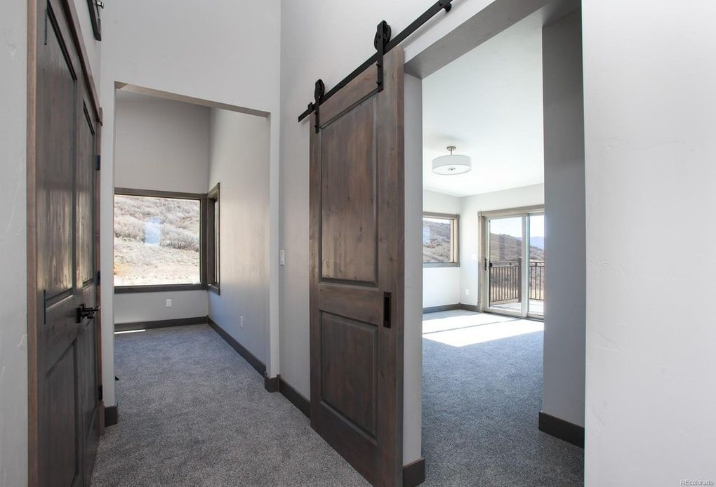 Top of the stairs, barn doors lead you into the master, washer/dryer on your left.