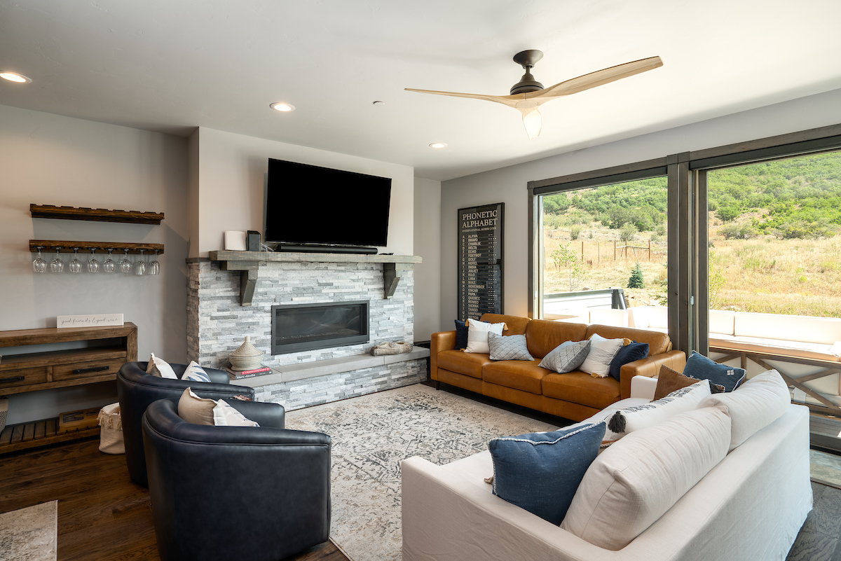 Beautiful modern living room with large windows looking out to open space!