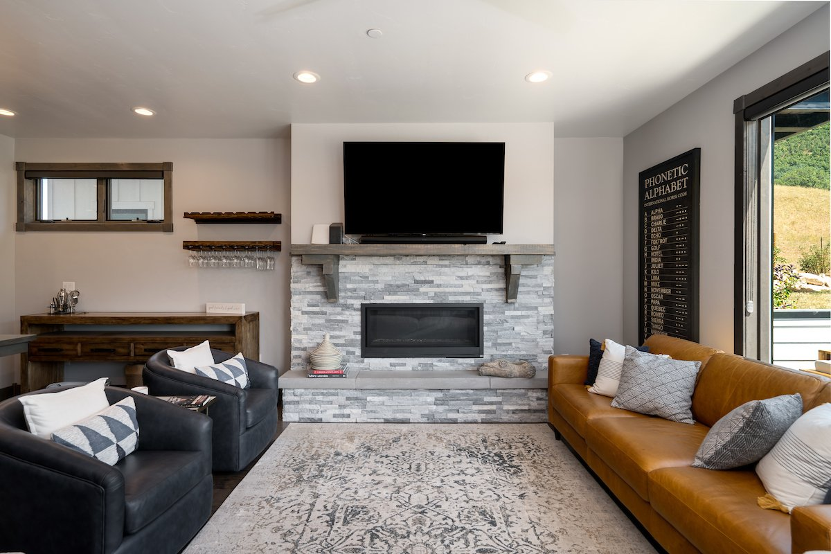 Stacked stone gas fireplace to warm up on wintry nights.
