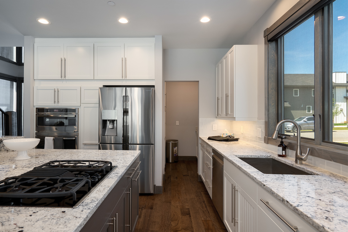 Gas stove, large refrigerator and plenty of cabinet space grace this brand new kitchen