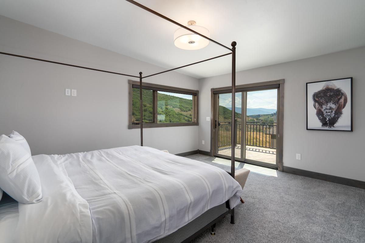 Master bedroom with sliding door to a large upper deck.